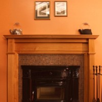 Regency B36XT gas fireplace with screen doors, glass tile surround, marble hearth and cherry mantel by Premier.