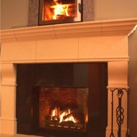 Valor Ventana gas fireplace with absolute black granite surround and stone mantel and hearth. Above; BIS Nova high efficiency wood-burning fireplace.