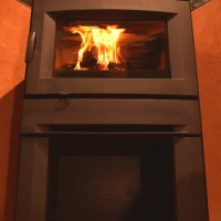 Regency Alterra, contemporary wood stove with wood storage area.