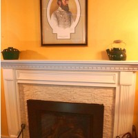 Valor G4 gas insert with ceramic log set and custom tile surround, Jackson painted mantel by Premier, and absolute granite hearth extension.
