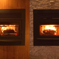 Supreme Opus see-thru high efficiency wood-burning fireplace with Dracme real stone and heart pine surrounds.