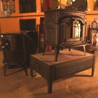 Vermont Castings Intrepid II classic black parlor stove, perfect for a small cabin.