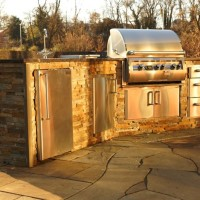 Outside our showroom - a glimpse of the luxury an outdoor kitchen can provide: Fire Magic Diamond Echolon e660i gas grill, side burner, rotisserie, refrigerator, sink, door and drawer sets. Ask about our chefs on staff!