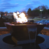 HPC copper bowl fire pit with water scupper and pond feature.