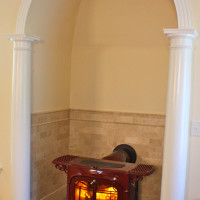 Vermont Castings Encore Wood-burning stove in an Alcove with Granite Hearth and Tile Surround