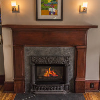 Valor Retrofire with Historic Cast Fireplace Cover and Soapstone Surround and Hearth
