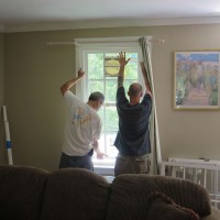 Jonathan and Parker push the perfect fitting replacement window into position.