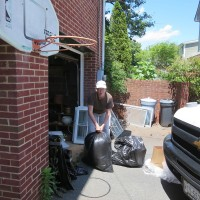 Leslie cheerfully assists in proper lead paint disposal.