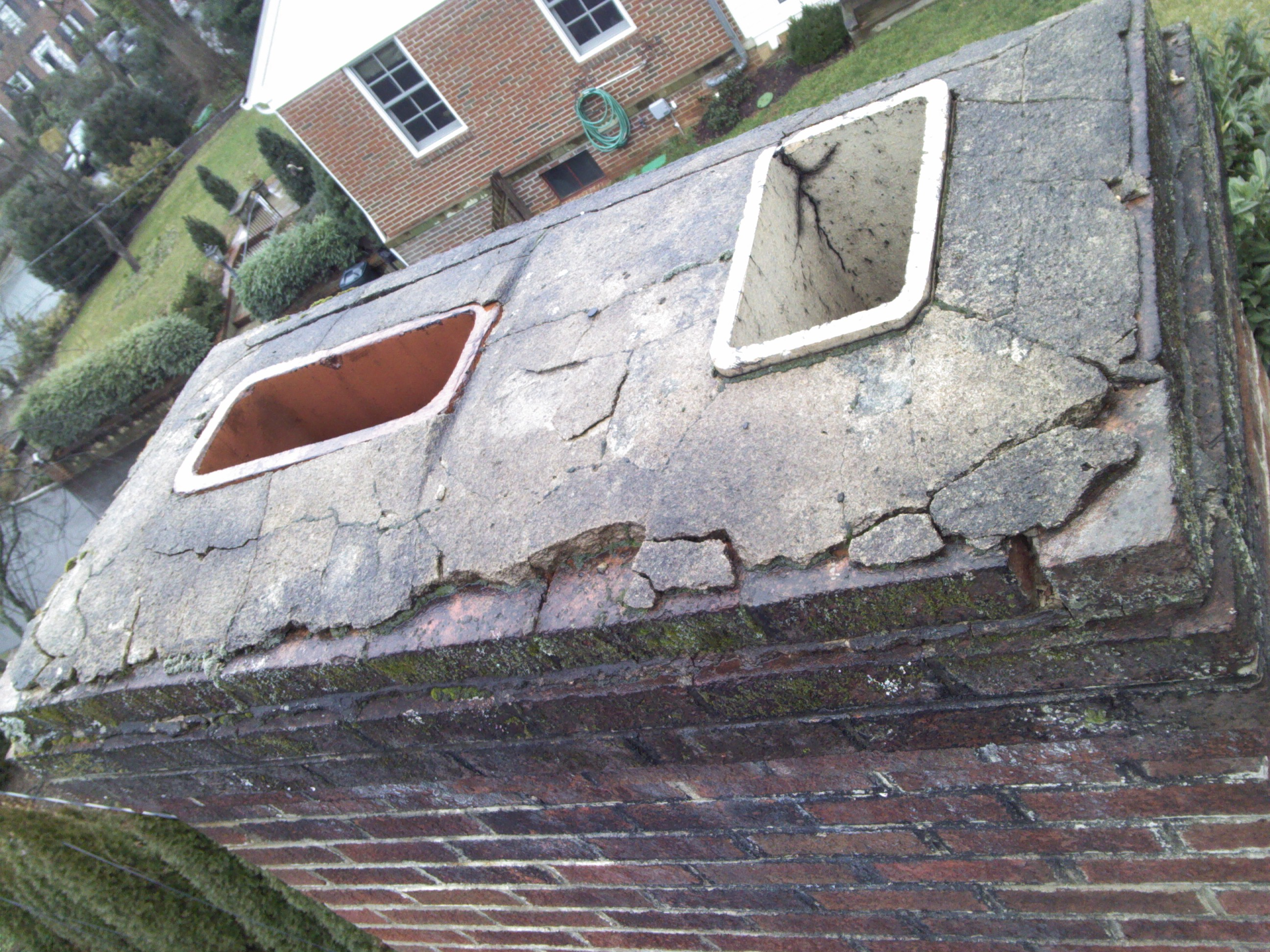 This wash is badly damaged and the flues are unprotected